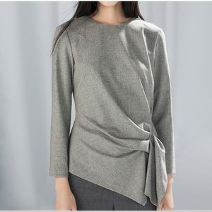Side ruched asymmetrical wool top